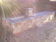 Habillage d'un ancien lavoir en pierres naturelles